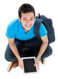 Estudiante con PC de la tablilla Fotografía de archivo