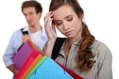 Estudiante con un dolor de cabeza Imágenes de archivo libres de regalías