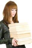 Estudiante con una pila de libros Imagen de archivo