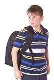 Estudiante contrariedad con una mochila de la escuela Imagen de archivo