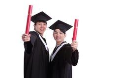 Estudiante de dos graduados feliz Fotos de archivo libres de regalías