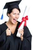 Estudiante de graduación con los pulgares del diploma para arriba fotografía de archivo libre de regalías