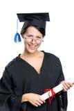 Estudiante de graduación en vidrios con el diploma imagen de archivo