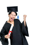 Estudiante de graduación que gesticula el puño con el certificado fotos de archivo libres de regalías