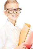 Estudiante de la escuela primaria con las carpetas Fotos de archivo libres de regalías