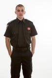 Estudiante de la policía que se coloca en uniforme Fotografía de archivo