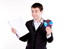Estudiante de la Universidad con el libro de textos y el Cd Imagen de archivo libre de regalías