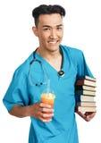 Estudiante de medicina con los libros Imagen de archivo libre de regalías