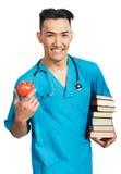 Estudiante de medicina con los libros Fotografía de archivo libre de regalías