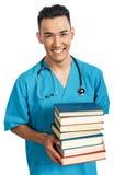 Estudiante de medicina con los libros Imágenes de archivo libres de regalías