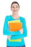Estudiante de mujer joven hermoso con el libro de trabajo. Imagenes de archivo