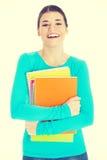 Estudiante de mujer joven hermoso con el libro de trabajo Imagen de archivo