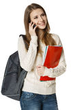 Estudiante de mujer sonriente que habla en el teléfono celular Fotografía de archivo