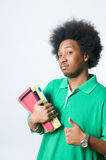 Estudiante del afroamericano con el libro de textos Fotografía de archivo