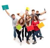 Estudiante del grupo con el cuaderno Imagen de archivo libre de regalías