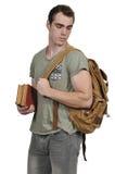 Estudiante del hombre con la bolsa de libros Fotos de archivo libres de regalías