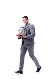 Estudiante del hombre de negocios que lleva sosteniendo la pila de libros aislados en w Fotografía de archivo libre de regalías