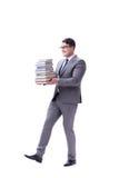 Estudiante del hombre de negocios que lleva sosteniendo la pila de libros aislados en w Fotos de archivo