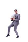 Estudiante del hombre de negocios que lleva sosteniendo la pila de libros aislados en w Imagenes de archivo