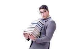 Estudiante del hombre de negocios que lleva sosteniendo la pila de libros aislados en w Imagen de archivo