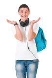 Estudiante del muchacho con la mochila y los auriculares Fotografía de archivo