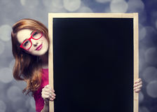 Estudiante del Redhead con la pizarra. Imagen de archivo libre de regalías