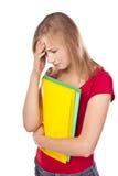 Estudiante desanimado en estudio. Blanco foto de archivo libre de regalías