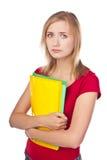 Estudiante desanimado que mira ficheros fotografía de archivo