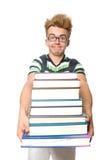 Estudiante divertido con la pila Fotos de archivo libres de regalías