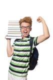 Estudiante divertido con la pila Foto de archivo libre de regalías