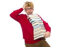 Estudiante divertido con los libros aislados en blanco Fotos de archivo