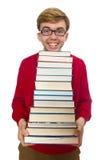 Estudiante divertido con los libros aislados en blanco Fotografía de archivo