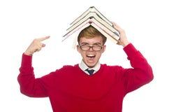 Estudiante divertido con los libros aislados en blanco Foto de archivo