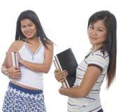 Estudiante dos con los libros Foto de archivo libre de regalías