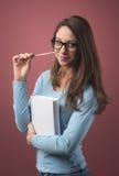 Estudiante elegante con los libros Imagen de archivo libre de regalías