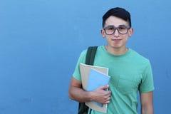 Estudiante elegante de la universidad hispánica feliz con el espacio de la copia Imagen de archivo