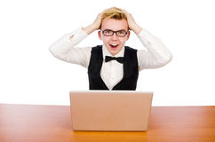 Estudiante elegante que se sienta con el ordenador portátil aislado encendido Foto de archivo libre de regalías