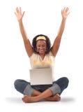 Estudiante emocionado con la computadora portátil Imagen de archivo