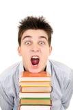 Estudiante emocionado con los libros Imagen de archivo libre de regalías