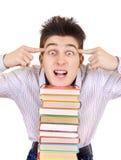 Estudiante emocionado con los libros Fotos de archivo libres de regalías