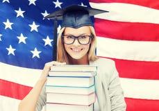 Estudiante en casquillo de la graduación Foto de archivo libre de regalías
