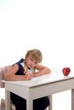 Estudiante en desk2 Imagenes de archivo