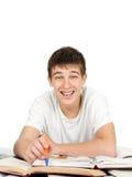 Estudiante en el escritorio de la escuela Imagen de archivo