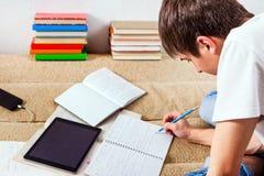 Estudiante en el hogar Imagen de archivo libre de regalías