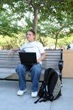 Estudiante en el ordenador Imagen de archivo
