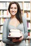 Estudiante en la biblioteca Fotografía de archivo
