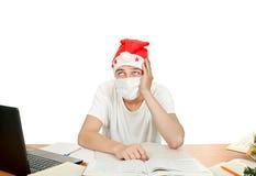 Estudiante en la máscara del sombrero y de la gripe de santa Imagenes de archivo