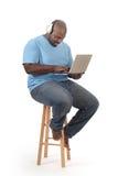 Estudiante en una computadora portátil Fotos de archivo libres de regalías