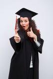 Estudiante en vestido de la graduación Imagen de archivo libre de regalías