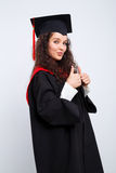 Estudiante en vestido de la graduación Fotos de archivo libres de regalías
